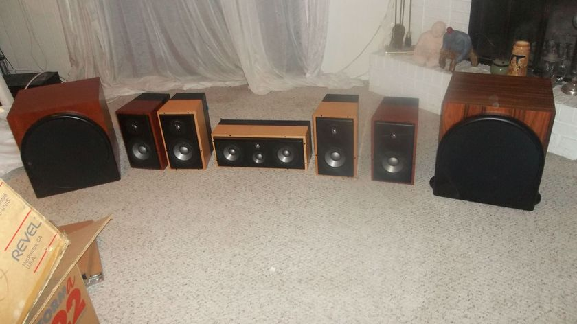 Revel performa speaker sets (willing to sell separately): two B15 subs, two M22 speaker sets, one C32 speaker. Natural cherry and maple finishes, lightly used with boxes